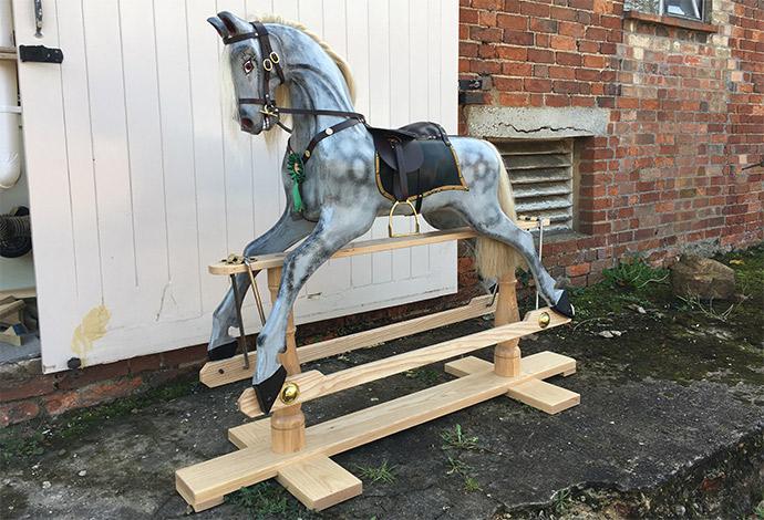 An antique style rocking horse seen diagonally