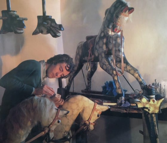 Jim Hignett painting a rocking horse in the old workshop