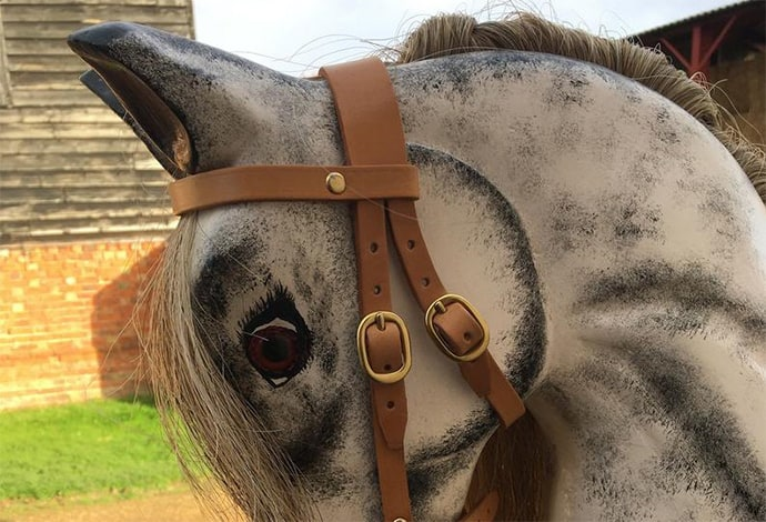 The head of a dapple grey rocking horse