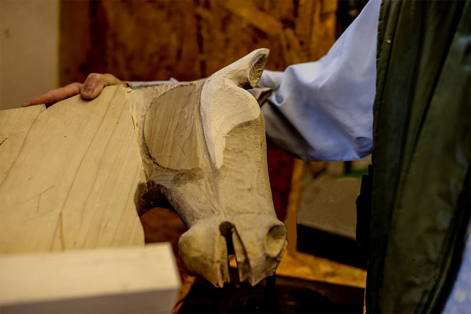 A carved rocking horse head being held by Jim Hignett