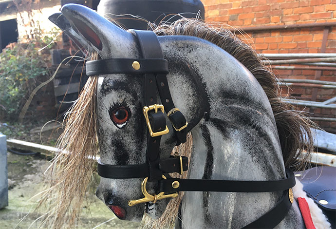 The head of a small antique style dapple grey rocking horse