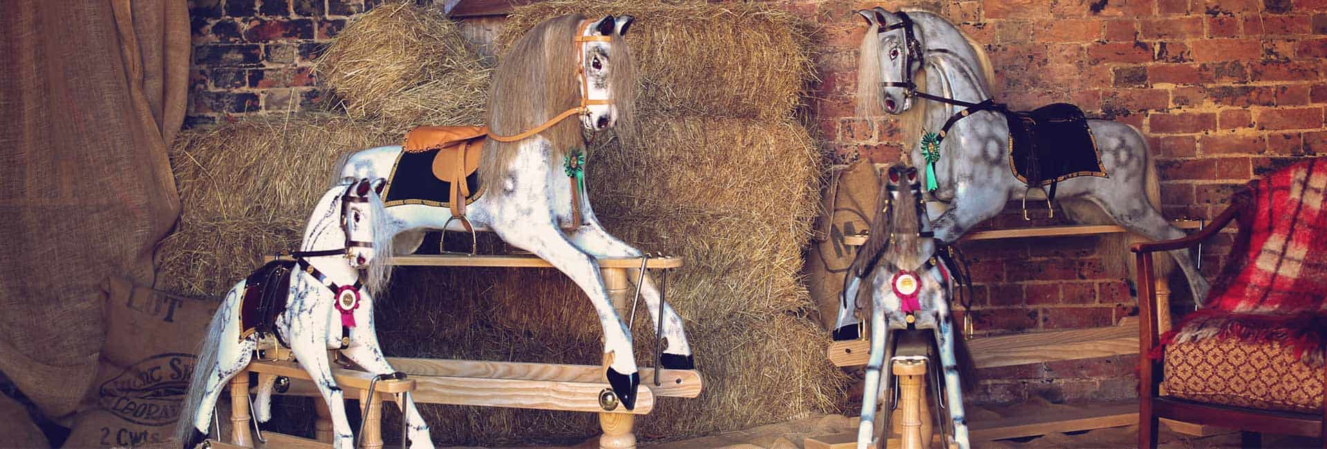 Two dapple grey horses in a stable