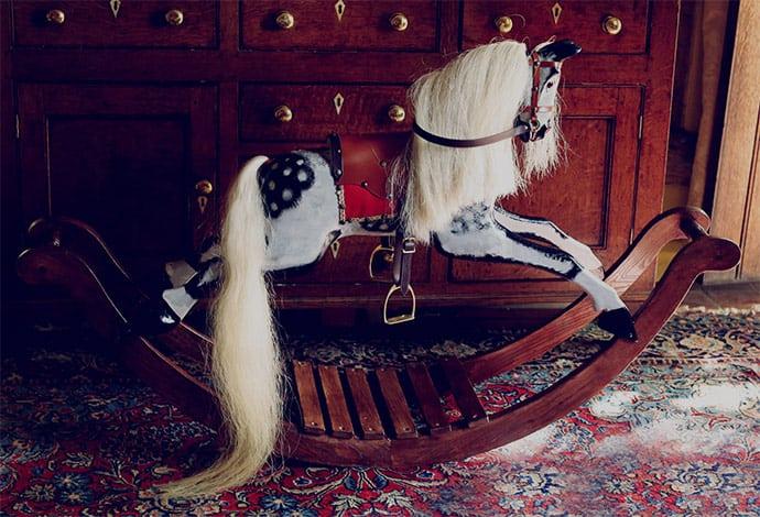 Bow rocker dapple grey rocking horse in a home